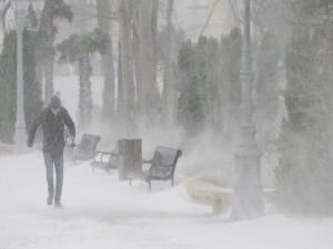 A man walks under heavy snow in Baku